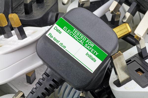 3pin 13 amp plug with PAT testing label