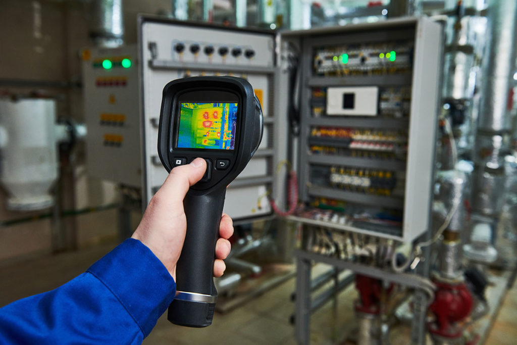 Hand with a thermal imaging tester